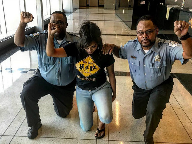 Chicago Police Officers Reprimanded After Photo of Them Kneeling on Duty Circulates Internet