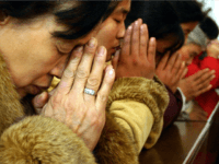 Chinese Christians pray during a midnight mass on Christmas eve at a church in Beijing, China, Friday, Dec. 24, 2004. Chinese authorities insist that Christians worship only in government-controlled churches. Despite harassment, fines and the possibility of prison, millions of Protestants and Catholics continue to attend unauthorized assemblies, including in private homes. (AP Photo/Str)