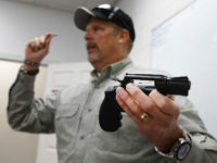 SPRINGVILLE, UT - JANUARY 9: Gun instructor Mike Stilwell, demonstrates a revolver as as he teaches a packed class to obtain the Utah concealed gun carry permit, at Range Master of Utah, on January 9, 2016 in Springville, Utah. Utahs permits, available for a fee to non-residents who meet certain …
