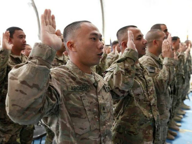 U.S. troops are sworn in as naturalized citizens on Nov. 2, 2012, at Bagram Airfield in Afghanistan. (State Department)