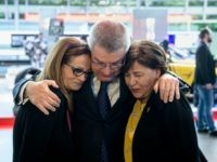 President of the International Olympic Committee Thomas Bach comforts Ilana Romano, widow of Israeli weightlifter Josef Romano, left, and Anke Spitzer, widow of Israeli fencing coach Andre Spitzer, right, during a commemoration ceremony on the occasion of the 45th anniversary of the death of 11 Israeli athletes killed by a …