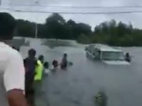 Drivers Form Human Chain to Rescue Elderly Man Caught in Houston Floodwaters in Hurricane Harvey.