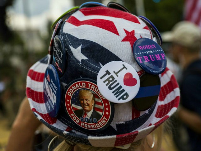 A demonstrator wears a hat with the colours of the US flag and pro-Trump slogans the 'Mother of All Rallies' in support of the US president held on the National Mall in Washington, DC on September 16, 2017. Supporters of President Donald Trump gathered in the US capital to show support of 'free-speech' dubbed the Mother of All Rallies. / AFP PHOTO / ZACH GIBSON (Photo credit should read ZACH GIBSON/AFP/Getty Images)