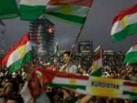 ERBIL, IRAQ - SEPTEMBER 22: Supporters wave flags and chant slogans inside the Erbil Stadium while waiting to hear Kurdish President Masoud Barzani speak during a rally for the upcoming referendum for independence of Kurdistan on September 22, 2017 in Erbil, Iraq. The Kurdish Regional government is preparing to hold the September 25, independence referendum despite strong objection from neighboring countries and the Iraqi government, which voted Tuesday to reject Kurdistan's referendum and authorized the Prime Minister Haider al-Abadi to take measures against the vote. Despite the mounting pressures Kurdistan President Masoud Barzani continues to campaign and state his determination to go ahead with the vote. (Photo by Chris McGrath/Getty Images)