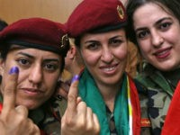 Female members of a Kurdish Peshmerga battalion show their ink-stained fingers after casting their vote in the Kurdish independence referendum in Arbil, on September 25, 2017. Iraqi Kurds voted in an independence referendum in defiance of Baghdad which has warned of 'measures' to defend Iraq's unity and threatened to deprive …