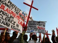 Pakistani Christians shout slogans in protest against the killing of Christian couple, in Islamabad on November 5, 2014. An enraged Muslim mob beat a Christian couple to death in Pakistan and burnt their bodies in the brick kiln where they worked for allegedly desecrating a Koran, police said. AFP PHOTO/Farooq …