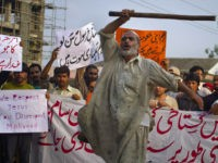 "A Pakistani worker shouts anti U.S. slogans during a rally in Islamabad, Pakistan on Saturday, Sept. 15, 2012 as part of widespread anger across the Muslim world about a film ridiculing Islam's Prophet Muhammad. The banner at bottom reads, ""'immediately hang the cursed man indulged in insulting the Prophet,"" while the banner at top left reads, ""Oh blasphemer! Listen we are after your life,"" and the banner at top, second left reads,""we urge the government to stop U.S. interference in the Pakistan."" (AP Photo/Anjum Naveed)"