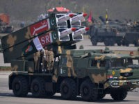 Pakistani military personnel stand beside short-range Surface to Surface Missile NASR during the Pakistan Day military parade in Islamabad on March 23, 2015. Pakistan held its first national day military parade for seven years, a display of pageantry aimed at showing the country has the upper hand in the fight against the Taliban. Mobile phone networks in the capital were disabled to thwart potential bomb attacks, some roads were closed to the public and much of the city was under heavy guard for the event. AFP PHOTO/ Aamir QURESHI (Photo credit should read AAMIR QURESHI/AFP/Getty Images)
