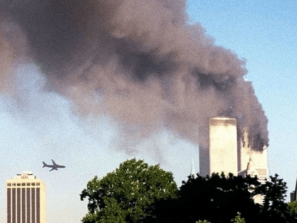 United Airlines Flight 175 approaches the World Trade Center. (AP Photo/ William Kratzke)