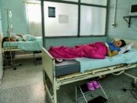Venezuelan nationals Dayana Zambrano (L) and Joselis Canas rest as they wait for their due date at the Erasmo Meoz University Hospital in Cucuta, North of Santander department, Colombia on July 25, 2017. Lack of food and medicine amid Venezuela's violent political crisis, threaten many pregnant women, pushing them to …
