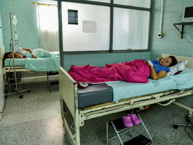 Venezuelan nationals Dayana Zambrano (L) and Joselis Canas rest as they wait for their due date at the Erasmo Meoz University Hospital in Cucuta, North of Santander department, Colombia on July 25, 2017. Lack of food and medicine amid Venezuela's violent political crisis, threaten many pregnant women, pushing them to migrate to Colombia to deliver their children safely. / AFP PHOTO / Luis ACOSTA / TO GO WITH AFP STORY by VALERIA PACHECO (Photo credit should read LUIS ACOSTA/AFP/Getty Images)