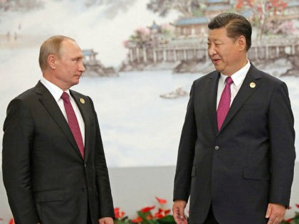 Russian President Vladimir Putin (L) and Chinese President Xi Jinping attend a photo session during a summit of the BRICS major emerging economies in Xiamen, China, on Sept. 4, 2017. (Pool photo)(Kyodo) ==Kyodo (Photo by Kyodo News via Getty Images)