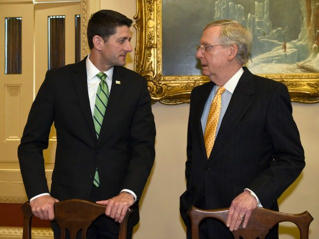 House Speaker Paul Ryan of Wis., left, talks with Senate Majority Leader Mitch McConnell of Ky., on Capitol Hill in Washington, Wednesday, April 13, 2016, before the start of an organizational meeting of the Joint Congressional Committee on Inaugural Ceremonies (JCCIC). (AP Photo/Susan Walsh)