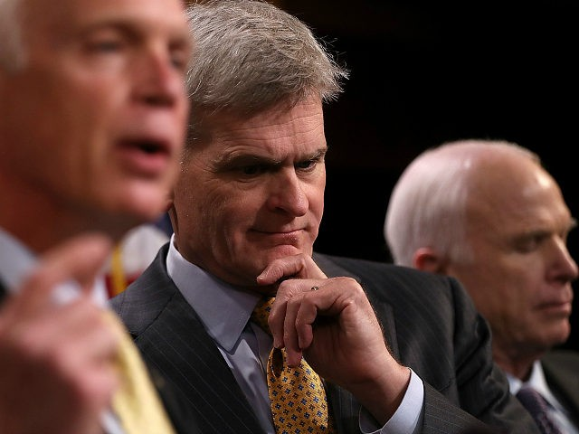 WASHINGTON, DC - JULY 27: U.S. Sen. Bill Cassidy (R-LA) looks on at a news conference, along with John McCain, held to announce opposition to the so-called skinny repeal of Obamacare at the U.S. Capitol July 27, 2017 in Washington, DC. The Republican senators said they would not support any legislation to repeal and replace Obamacare unless it included a guarantee to go to conference with the House of Representatives. (Photo by Justin Sullivan/Getty Images)