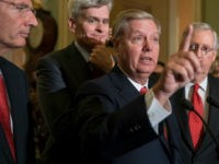 Sen. Lindsey Graham, R-S.C., joined by, from left, Sen. John Barrasso, R-Wyo., Sen. Bill Cassidy, R-La., and Senate Majority Leader Mitch McConnell, R-Ky., speaks to reporters as they faced assured defeat on the Graham-Cassidy bill, the GOP's latest attempt to repeal the Obama health care law, at the Capitol in …