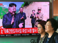 North Korean leader Kim Jong-Un hinted that he would hold off on plans to test-fire missiles towards Guam