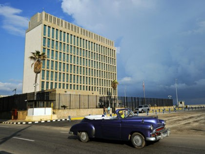 "An old American car passes by the US Embassy in Havana on December 17, 2015. The United States announced Thursday the resumption of regular flights to and from Cuba, the latest step in a historic thaw in relations. ""On December 16, the United States and Cuba reached a bilateral arrangement …"
