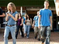 People walking while using cell phones