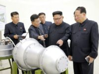 North Korean leader Kim Jong-Un was pictured inspecting a device at the nation's Nuclear Weapons Institute