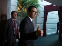 US Treasury Secretary Steven Mnuchin gives a thumbs up as he arrives at a House Republican Conference to push for President Donald Trump's hurricane relief package and the lifting of the US debt ceiling