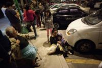 Residents gather on a street in Mexico City on September 7, 2017, after an earthquake of magnitude 8.1 struck the south and was felt as far away as the capital
