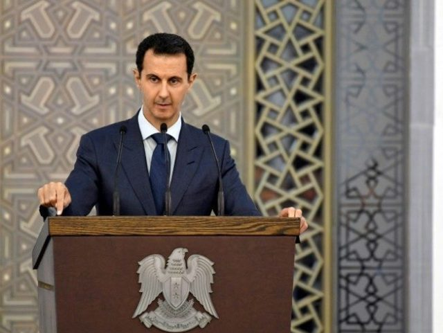 President Bashar al-Assad addresses members of Syria's diplomatic corps buoyed by battlefield successes in this picture released by state media on August 20, 2017