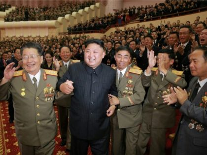 This undated picture released by North Korea's official Korean Central News Agency (KCNA) on September 10, 2017 shows North Korean leader Kim Jong-Un (front 2nd L) attending an art performance dedicated to nuclear scientists and technicians