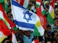 An Israeli flag is waved alongside Kurdish flags during an event in Iraqi Kurdistan's capital of Arbil to urge people to vote in a September 25 independence referendum