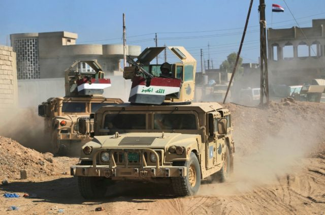 Humvees of the combined Iraqi forces and Popular Mobilization units advance through the town of Tal Afar, west of Mosul August 26, 2017