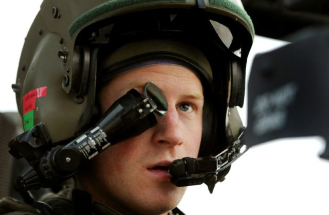 Britain's Prince Harry wearing his monocle gunsight as he sits in his Apache helicopter in Afghanistan in 2012