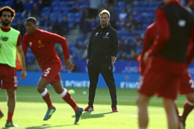Liverpool's manager Jurgen Klopp watches his players warm up on September 23, 2017