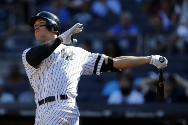 Aaron Judge of the New York Yankees hits a solo home run against the Kansas City Royals during the seventh inning at Yankee Stadium on September 25, 2017 in the Bronx borough of New York City