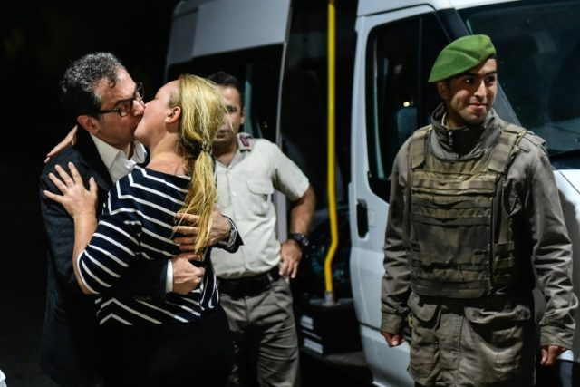 Veteran Turkish journalist Kadri Gursel kisses his wife Nazire after his release from Silivri prison outside Istanbul