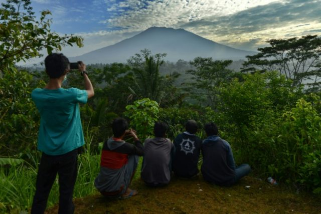 People look at Mount Agung in Karangasem on the Indonesian resort island of Bali on September 24, 2017