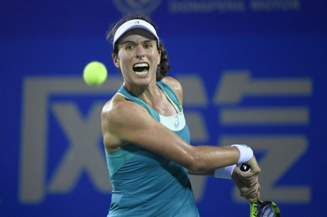 Johanna Konta of Great Britain hits a return against Ashleigh Barty of Australia during their first round women's match at the WTA Wuhan Open tennis tournament in Wuhan, in China's central Hubei province on September 25, 2017