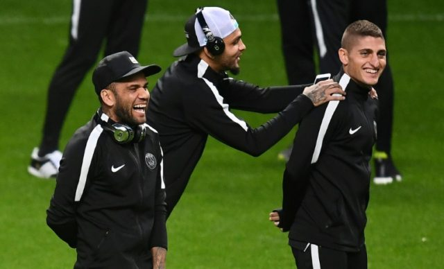 (From L) Paris Saint-Germain's Dani Alves, Layvin Kurzawa and Marco Verratti share a joke during a training session in Glasgow, on September 11, 2017
