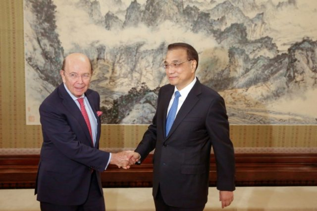 Wilbur Ross (L) met with Li Keqiang (R) in Beijing ahead of Trump's trip to China, which is expected to take place in November