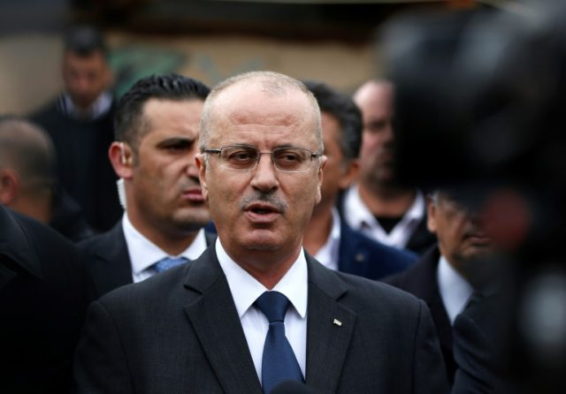 Palestinian prime minister Rami Hamdallah, seen here in March, will travel to the Gaza Strip on October 2 as part of renewed reconciliation efforts with Hamas