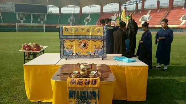 Fans of the club invited Taoist priests on to the pitch to pray for a good result in Sunday's match with Shandong Luneng, which Henan went on to win 2-1