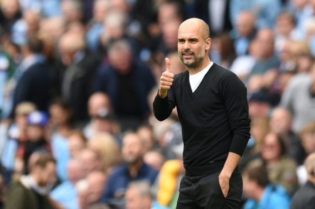 Manchester City's Spanish manager Pep Guardiola gives a thumbs up after City scored their second goal during the English Premier League match against Crystal Palace at the Etihad Stadium in Manchester on September 23, 2017