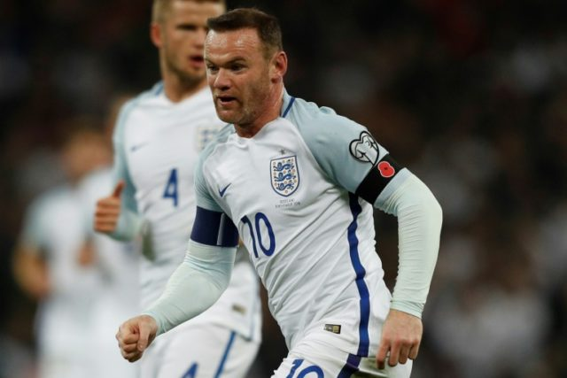 England's Wayne Rooney wears a poppy armband to commemorate Armistice Day during a 2018 World Cup qualification match against Scotland at Wembley Stadium in London on November 11, 2016