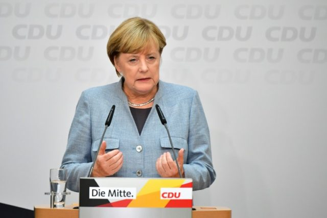 Merkel's conservative CDU/CSU group saw its number of seats axed to 246 from 309 previously following its worst poll showing in seven decades.