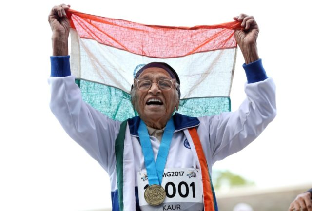 Indian runner Man Kaur, 101, celebrates after competing in the 100m sprint in the 100+ age category at the World Masters Games in Auckland in April 2017