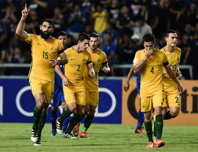 Australian players celebrate after captain Mile Jedinak scored a penalty against Thailand during their 2018 FIFA World Cup qualifying match, in Bangkok, in November 2016