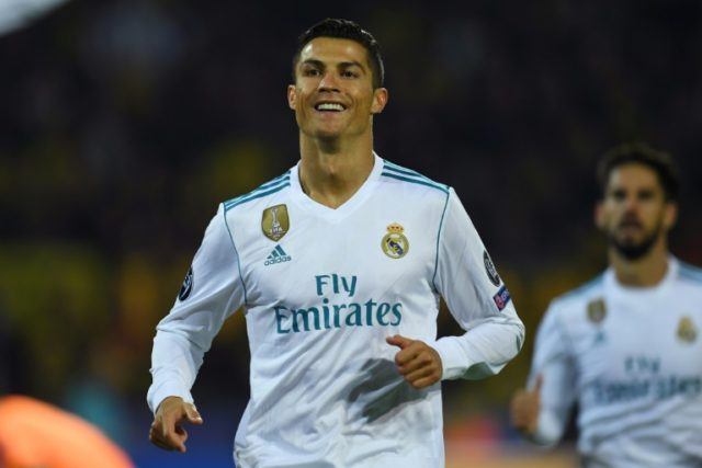 Real Madrid's forward Cristiano Ronaldo celebrates scoring with his teammates during the UEFA Champions League Group H football match against BVB Borussia Dortmund September 26, 2017