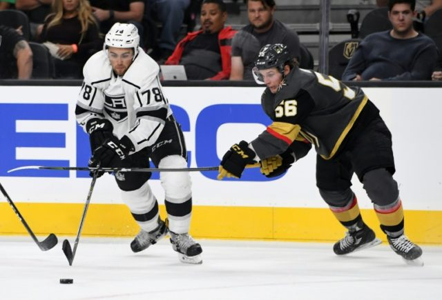 Alex Iafallo (L) of the Los Angeles Kings fights for the puck with Erik Haula of the Vegas Golden Knights during their exhibition game at T-Mobile Arena in Las Vegas, Nevada, on September 26, 2017