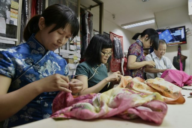 """Lin Chin-te, 74, is among a handful of craftsmen in Taiwan who still specialise in handmaking the high-collar, figure-hugging """"qipao"""" which was once part of many women's daily wardrobes"""