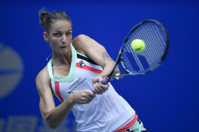 Czech's Karolina Pliskova hits a return against Shuai Zhang of China during their second round women's singles match at the WTA Wuhan Open tennis tournament on September 26, 2017