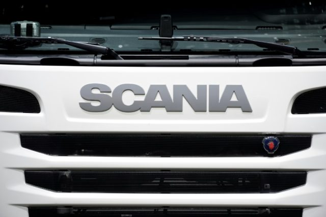 Truckmaker Scania gets hit with a massive 880-million-euro fine from the EU.