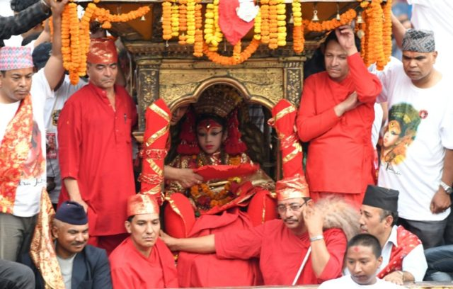Once she is anointed a living goddess, the Kumari is only allowed to leave her new home 13 times a year on special feast days, when she is paraded through Kathmandu in ceremonial dress and elaborate makeup to be worshipped